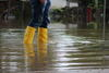 In Gummistiefeln im Hochwasser